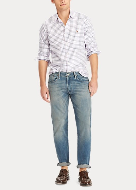 Light wash jeans with a check shirt and brown shoes